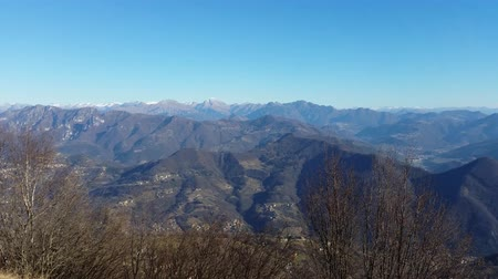 superb : Great landscape with fantastic blue sky on the Orobie Alps and the Po plain in the dry winter season without snow. Panorama from Linzone Mountain, Bergamo, Italy. Stock Footage