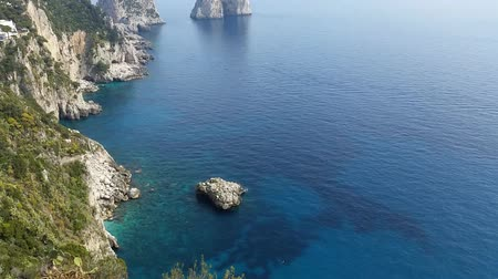 augustus : Capri (Naples), Campania area, Italy. Aerial footage of the beautiful and well known Faraglioni. The three spurs of rock Which rise up out of the sea in a wonderful day.