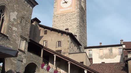 reason : Bergamo - Old town. Landscape on the ancient Administration Headquarter called Palazzo della Ragione and the clock tower called Il Campanone Stock Footage