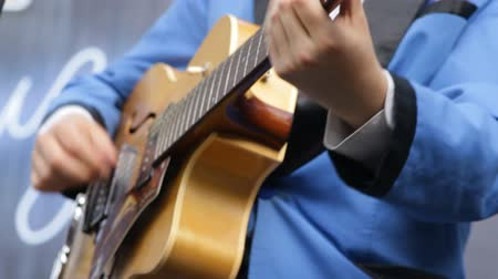 jazzman : Musician playing vintage the guitar close-up.