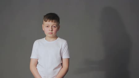 scold : Shadow of angry mother scolds crying son. Domestic violence and children abuse concept. Stock Footage