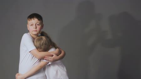 scandal : Little boy and girl and silhouettes of quarreling parents on background. Shadows of parents fighting, upset daughter and son in foreground. Domestic violence concept.