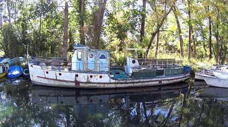 ohrid : Old abandoned boat moored to jetty in canal
