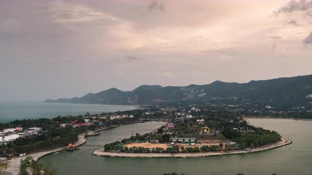 Day to night timelapse view of Chaweng town,Samui, Thailand it located in valley and near the sea and cloudy, rainy and windy flow across the town