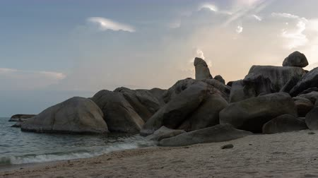 surat : Clouds move over the stone call Hin Ta Hin Yai while sunset time in Samui island, Suratthani, Thailand, famous landmark in Samui island