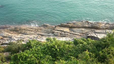 Wave hitting the rock on coastline in aerial view at Koh Samui, Thailand
