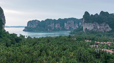 aonang : railay viewpoint on sunset time, a little town with green coconut garden and mountain background