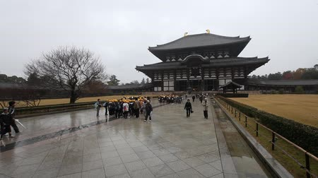 NARA, JAPAN - NOVEMBER 26: Unidentified tourists travel to the Main Hall of Todaiji Temple on November 26, 2012 in Nara, Japan. This hall is the worlds largest