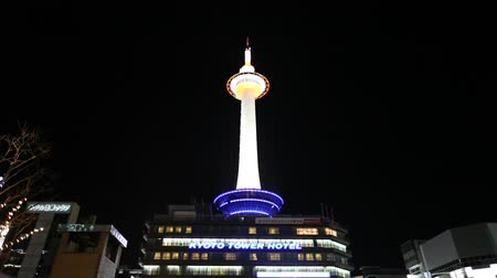 KYOTO, JAPAN - NOVEMBER 30: Nighttime illumination at Kyoto Tower on November 30, 2012. Kyoto tower is the tallest structure in Kyoto 131 meters and stands opposite Kyoto Station. Stock Footage