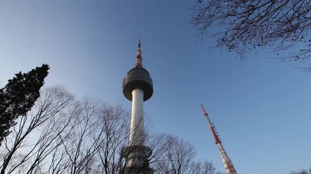 SEOUL, SOUTH KOREA - DEC 18: Pan shot of N Seoul Tower with blue sky on December 18, 2012 in Seoul, Korea. Built in 1969,since then, the tower has been landmark and marks the highest point in Seoul.