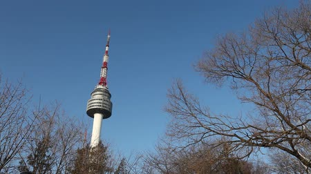 SEOUL, SOUTH KOREA - DEC 18: N Seoul Tower with blue sky on December 18, 2012 in Seoul, Korea. Built in 1969,since then, the tower has been landmark and marks the highest point in Seoul.