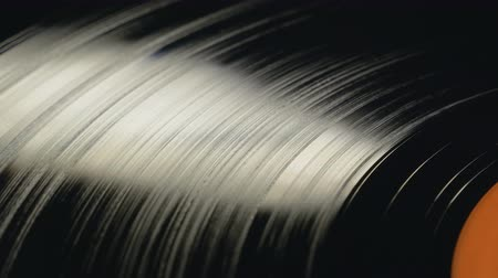 dal : Vinyl Record playing on DJ turntable, view from above in closeup