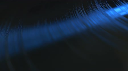 винил : Close up footage of rotating professional vinyl record in soft blue light, view from above. More options in my portfolio