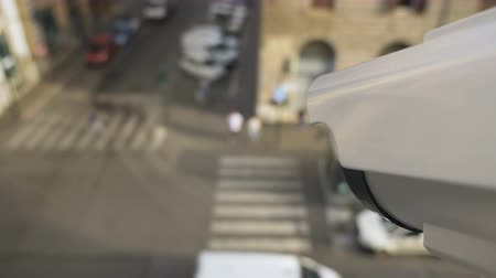 uznání : Surveillance camera monitors the flow of people and cars in the city. Modern video monitoring and surveillance systems. First-person view footage