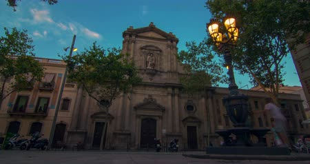 historical building : Travel landmarks of Barcelona at sunset. Theater facade, Barcelona. Time lapse of landmarks in Spain at sunset. Tourists walking near old building in Barcelona at evening. European architecture