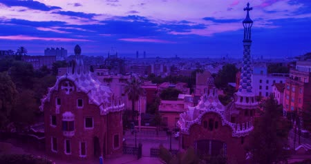 Каталония : Barcelona skyline. Park Guell designed by Antoni Gaudi in Barcelona. Timelapse of cityscape view in morning. Time lapse of clouds over european city at sunrise. View of travel landmarks in Spain Стоковые видеозаписи