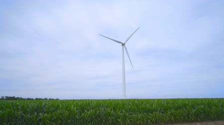 natural resource : Wind generator. Wind power generation. Close up of wind generator rotating on farm field. Sustainable energy resources. Wind power station on green field. Natural resources. Renewable energy Stock Footage