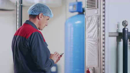 functionality : Factory worker check factory equipment. Factory engineer control functionality equipment. Industrial worker controlling industrial equipment. Close up of factory employee check industrial equipment Stock Footage