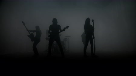концерт : Rock band silhouettes performing rock concert on stage. Rock music band. Music concert group. Show rock musicians. Music group silhouette. Playing musical instruments