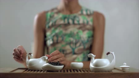 tradição : Tradition brewing green tea. Preparation teapot and cup for drinking. Tea ceremony Ã'Â�oncept. Traditional process of tea drinking preparation. Concept of chinese tea process