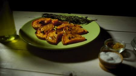 prepared foods : Chef hand put rosemary herb on roasted pumpkin dish. Traditional autumn cooking. Vegetarian diet dinner. Tasty pumpkin dish. Chef serving baked pumpkin pieces. Roast pumpkin slice