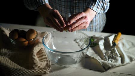 broken glass : Man hand breaks chicken egg in bowl. Chicken egg falls into glass bowl. Ingredients for baking. Chef cooking food. Culinary ingredients. Chef cracked egg in glass bowl. Baking ingredients