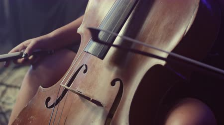 houslista : Cello player. Cellist playing violoncello. Close up of cello. Cello silhouette. Cello player cellist playing orchestra musical instrument. Classical musical instrument Dostupné videozáznamy