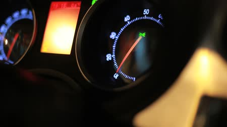 velocímetro : Dashboard of moving car. Tachometer and speedometer readings in moving auto. Tachometer arrow revving in moving car. Sports car control panel. Passanger view of car dashboard