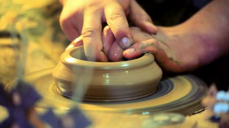 kamenina : Potter make clay dishes. Master hands working on potters wheel. Traditional process making dishes on potters wheel. Close up of traditional making pottery on potters wheel