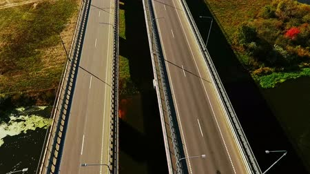 мостовая : Car bridge over river. Drone view of highway bridge above river. Cars and truck driving along highway bridge. Highway road on river landscape. Cars moving on road aerial view