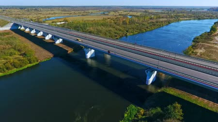 příjezdová cesta : Road bridge river. Drone view of highway road and car bridge over water. Highway road above river. Highway bridge on river landscape. Aerial bridge river landscape. Aerial landscape highway