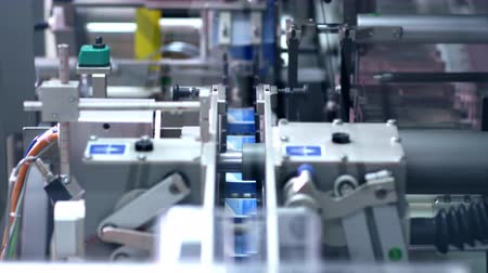 pharmaceuticals : Packaging line at pharmaceutical factory. Pharmaceutical industry. Medical drugs on packaging machine. Pharmaceutical manufacturing packaging process. Pharmaceutical packaging