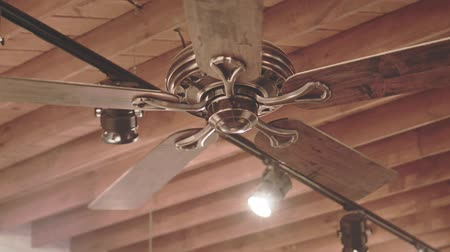 conditioner : Ceiling fan on wooden roof. Electric ceiling fan rotating slowly and air circulation. Air circulation. Cooling fan. Ventilation fan on ceiling. Wooden roof background