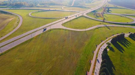 enrolamento : Drone view cars traffic on highway junctions. Beautiful landscape highway interchange. Cars driving on freeway intersection. Interchange highway road. Aerial landscape road junction sign