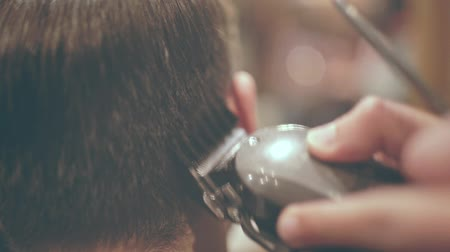 shaver : Cutting hair with electric razor. Close up of male haircut. Male hairstyle. Hairdressing. Man haircut. Barber haircut. Hairdresser cutting hair. Man hairstyle
