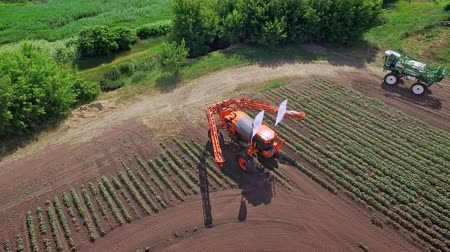fertilizing : Agriculture fertilizer. Spraying machine on agricultural field transformed for fertilizing plant. Drone view agricultural sprayer preparing to irrigate on farming field. Agricultural industry Stock Footage