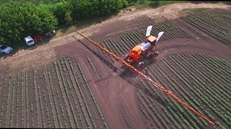 fertilizing : Irrigation agriculture machine. Agricultural sprayer moving on farming field and making watering plant. Sky view process irrigating agricultural field using fertilizer spreader. Fertilizer agriculture