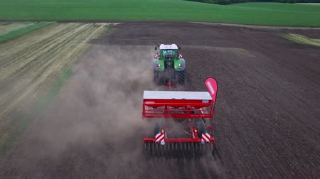 seeder : Sowing machine working on plowed field. Aerial view sowing machine on agricultural field. Agricultural industry. Farming equipment for field sowing. Agriculture machinery. Agriculture industry