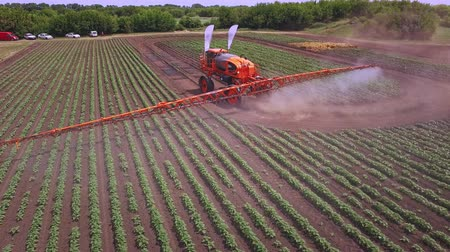 irrigate : Process irrigation on farming field using agriculture fertilizer. Drone view agriculture fertilizer working on cultivated field. Fertilizer agriculture. Agriculture spraying. Pesticide spraying