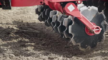agrarian : Agriculture equipment detail. Plow blades sowing machine. Close up sowing machine on agricultural field. Agricultural equipment for field sowing. Farming machinery. Agricultural technology Stock Footage