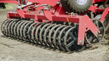 seeder : Sowing machine. Close up seeders sowing machine. Farming agriculture. Modern farming equipment for field sowing. Agricultural machinery. Farming industry. Rural farming