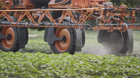 seeder : Agricultural sprayer driving on agricultural field. Spraying machine. Agricultural machinery field irrigation. Farming equipment. Close up of agriculture vehicle Stock Footage