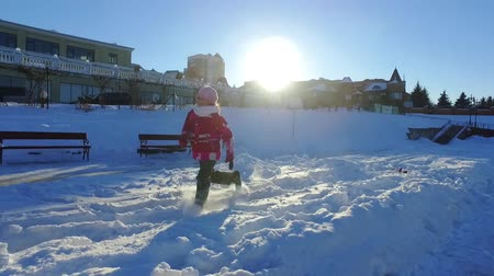 Mother playing with little daughter on snow. Winter family fun in slow motion. Snow holiday family concept. Happy wintertime. Winter snow games Wideo
