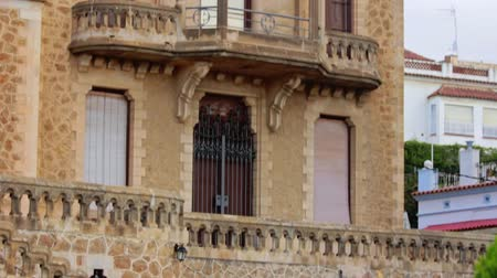 elaboração : Stone facade architectural building with high windows and balconies. Historic building in European city with wrought iron gates and balconies