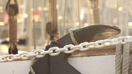 Ropes and chains on sailing yacht in boat port. Ropes and chains holding sail on yacht boat in sea port Wideo