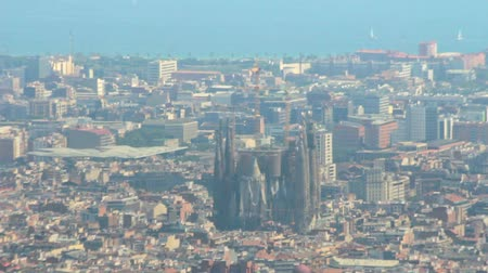 modernist : Panoramic view Sagrada Familia in Barcelona among modern buildings city. Famous architectural structure of designer Antonio Gaudi at Barcelona city