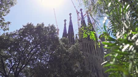 construction crane : Old catholic church in modern European city. Panoramic view of La Sagrada Familia cathedral in Barcelona city. Barcelona city sightseeings