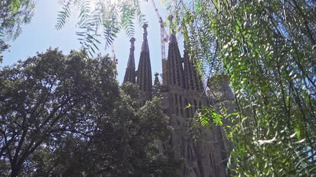 La Sagrada Familia cathedral in Barcelona city. Panoramic view of old catholic church in modern European city. Historical building by Antonio Gaudi