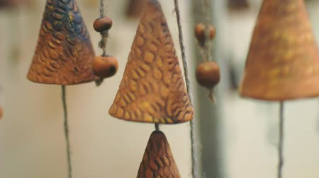 shui : Chinese bells hanged indoors. Close up of antique Feng shui amulet for luck and protection. Wind swinging clay bells slowly. Feng shui chimes