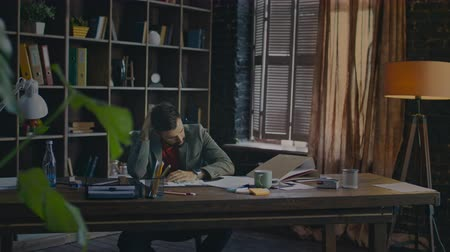 değil : Tired businessman can not concentrate on work. Frustrated businessman in home office. Business man tired at end of day in cozy office. Tired worker in office